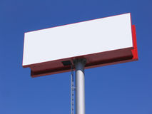 Blank billboard over blue sky. Large white blank billboard over blue sky Royalty Free Stock Photography