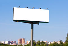Blank billboard over blue sky Royalty Free Stock Photo