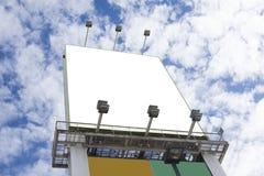Blank billboard over blue sky. stock photos