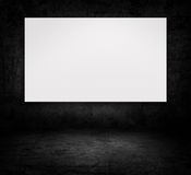 Blank billboard over dark concrete wall Royalty Free Stock Image