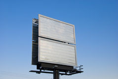 Blank billboard over the sky. Picture of a blank billboard over a clear blue sky Royalty Free Stock Photos