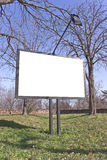 Blank billboard in a park Stock Images