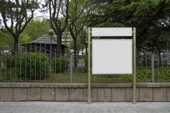 Blank billboard in a park Royalty Free Stock Image