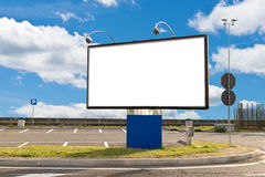 Blank billboard in a parking on a sunny day Stock Photos
