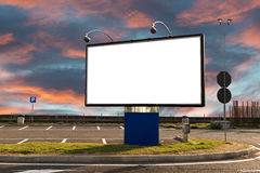 Blank billboard in a parking at sunset Royalty Free Stock Image