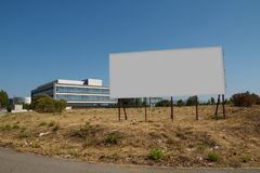 Blank billboard in a plot. For sale, development Royalty Free Stock Photography