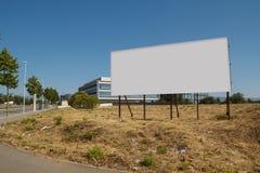 Blank billboard in a plot. For sale, development Stock Images