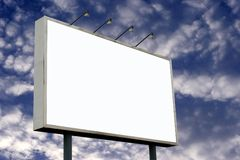 Blank Billboard and Pluffy Clouds Stock Image