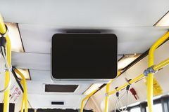 Blank Billboard in Public Subway. Black TV without information inside the bus. Video advertising in public transport. Mock up electronic media board with copy royalty free stock photos