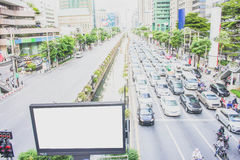 Blank billboard for putting text or image on the road with traffic jam. Blank billboard (For putting text or image) on the road with traffic jam , city center Stock Photography