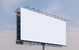 Blank billboard ready for new advertisement with blue sky backgr Stock Photos