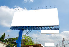 Blank billboard ready for new advertisement and blue sky Stock Photos