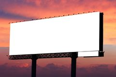 Blank billboard ready for new advertisement on dramatic sunset sky with clouds background stock image