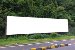 Blank billboard ready for new advertisement at green park zone Royalty Free Stock Images