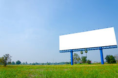 Blank billboard ready for new advertisement on meadow Royalty Free Stock Photos