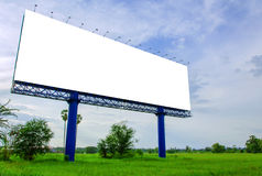 Blank billboard ready for new advertisement on meadow Royalty Free Stock Image