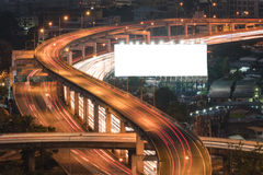 Blank billboard ready for new advertisement at Motorway, Express. Way, Freeway in modern city downtown, urban view at night time royalty free stock image