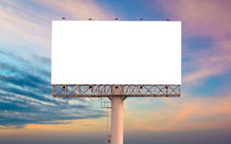 Blank billboard ready for new advertisement with sunset backgrou Stock Photos