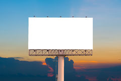 Blank billboard ready for new advertisement with sunset backgrou Royalty Free Stock Images