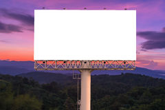 Blank billboard ready for new advertisement with sunset backgrou Stock Images