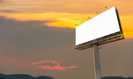 Blank billboard ready for new advertisement with sunset backgrou Stock Photo