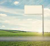 Blank billboard on the road Royalty Free Stock Photography