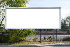 Blank billboard at roadside Royalty Free Stock Images