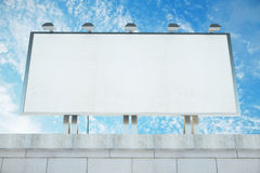 Blank billboard on the roof of building at blue sky background, Royalty Free Stock Photography