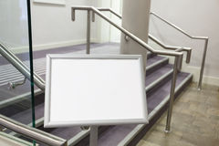 Blank billboard in the room with stairs. Royalty Free Stock Image
