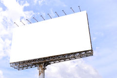 Blank billboard with rusted structure against blue sky for advertisement Stock Photos