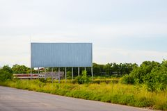 Blank billboard on the sideway in the park. image for copy space, advertisement, text and object. white billboard in natural green. Blank billboard ready for stock photography