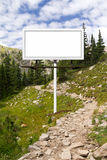 Blank Billboard Sign Along Mountain Trail Stock Photo