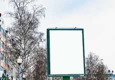 Blank Billboard on the street on the background trees and sky, winter urban landscape,. Mock up Stock Image