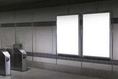 Blank billboard in subway or metro station, Useful for advertising. stock images