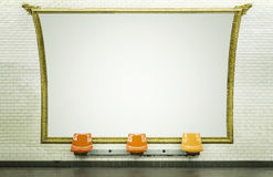 Blank billboard in subway station. Blank billboard in Paris subway station with empty chairs stock images