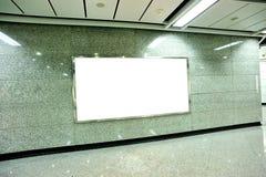Blank billboard in subway. Underground passage Royalty Free Stock Photos