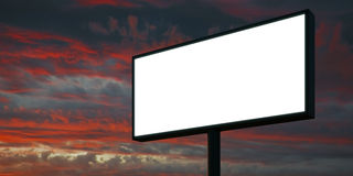 Blank billboard at sunset time ready for advertisement. 3d render. Blank billboard with blank digital screen ready for new advertisement, cloudy sky background royalty free stock image