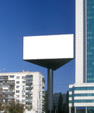 Blank billboard taken against a blue sky. Blank billboard taken against a brilliant blue sky and high rise. Kyiv, Ukraine Stock Images
