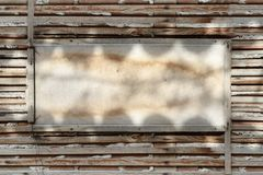 Blank billboard. Among timber laths royalty free stock photography