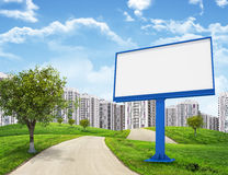Blank billboard and tree by road running through Royalty Free Stock Image