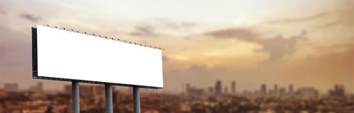 Blank billboard at twilight. For design work royalty free stock images