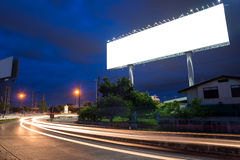Blank billboard at twilight time ready for new advertisement Royalty Free Stock Image