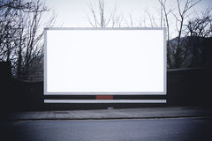 White billboard. Blank billboard with white space for your own design stock photos