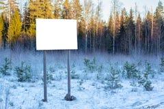 Blank billboard in winter woods Stock Photos