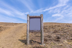 blank billboard wooden in the mountain landscape Royalty Free Stock Photos