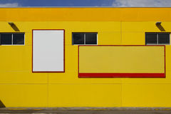 Blank billboard in a yellow wall Royalty Free Stock Photos