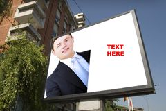 Blank billboard and young businessman Royalty Free Stock Image