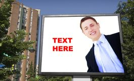 Blank billboard and young businessman Royalty Free Stock Photography