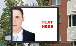 Blank billboard and young businessman Royalty Free Stock Photos