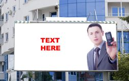 Blank billboard and young businessman Stock Image